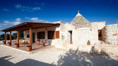 Photo for TRULLO IN VILLA WITH POOL, GARDEN WITH OLIVE TREES SECULAR, WI-FI, BARBECUE