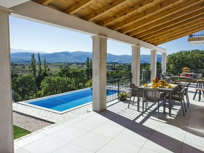 Photo for Splendid villa with infinity pool, beautiful covered terrace with panoramic view