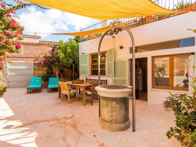 Photo for Typical 19th-century town house with jacuzzi – Casa Mitja