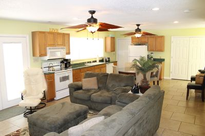 Light filled great room offers tables & chairs for 12 & fully equipped kitchen.