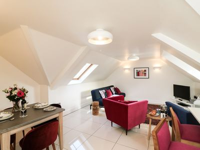 Photo for THE COACH HOUSE, with a garden in Poole, Ref 968393