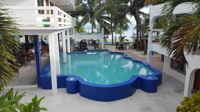 Photo for Beach front property, 'garden room', breakfast and rum punch included- CDM