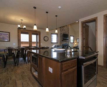 Open floor plan! Our kitchen is stocked with everything you might need!