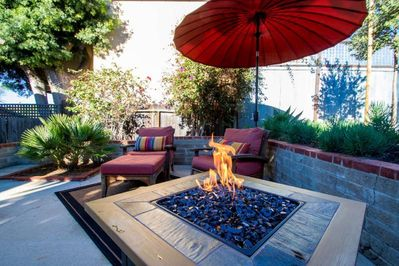 Rear private patio with BBQ grill, hammock, and gas fire-pit.