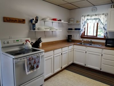 Photo for Century farmhouse with 4 bedrooms and large outside deck.