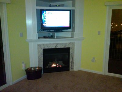 Flat screen HDTV and gas fireplace in upstairs family room