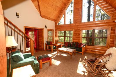 Great room with rustic furniture, acthedral ceiling and fabulous views.