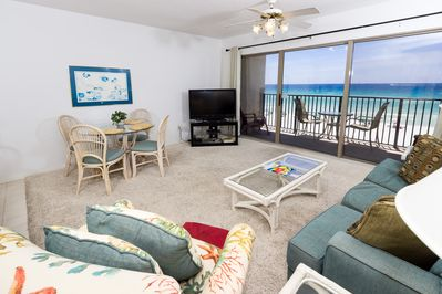 Spacious beach front living room with seating for everyone. - Spacious beach front living room with seating for everyone.
