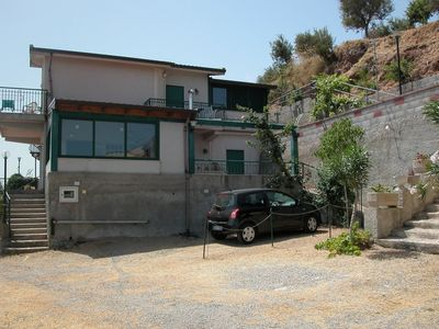 Photo for Charming cottage overlooking the coast and Aeolian Islands