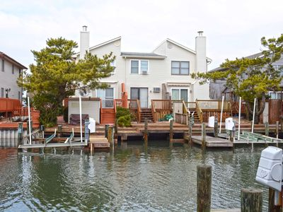 Photo for Adorable 2 bedroom townhouse on canal with free WiFi and boat dock located downtown on the bayside!