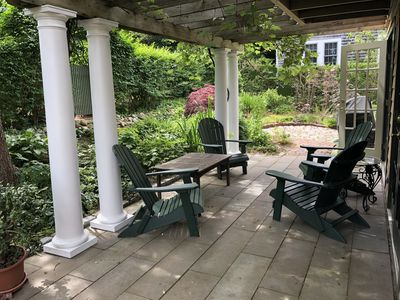New Patio, Columns & Outdoor chairs in garden setting