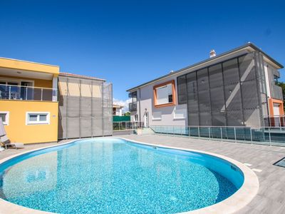 Photo for Two-bedroom apartment with balcony and pool view in Funtana, near the beach