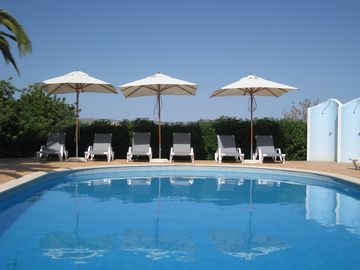 Enjoy the large pool and green surroundings. Close to the beach and quiet.