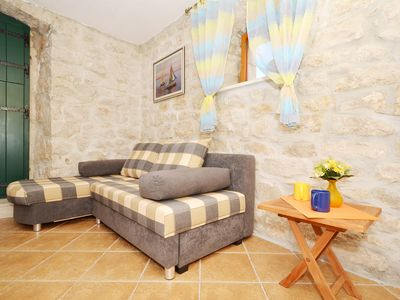 Photo for Villa Maslina 1 - charming rustic one bedroom apartment with garden