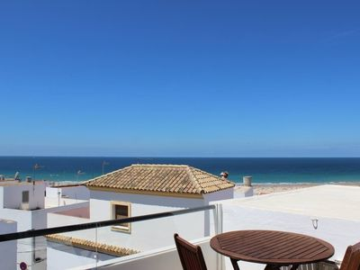 Photo for exclusive townhouse, just 120m from the beach, with fantastic seaviews from private terrace, for 2-4 persons, a/c warm/cold, SAT-TV, with own garage-parking, free Wi-Fi, safe.