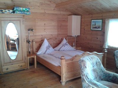 Photo for Holiday in a rustic holiday log cabin with flair - new shower room, beach about 1 km