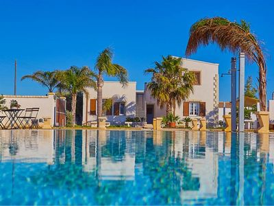 Photo for Amazing villa in modern style / Big infinity pool in the garden / Bright and coloured rooms / 10 Sle