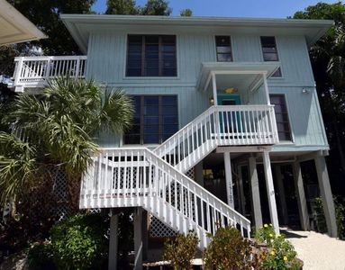 Photo for Wonderful beach house in the Sunset Captiva community. Pool, tennis, boat dock, BBQ grill, and the b