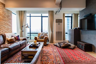 Living room with authentic leather sofas and Persian rugs