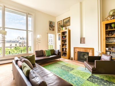 Photo for Colourful and spacious 1BR minutes from Eiffel Tower, by Veeve