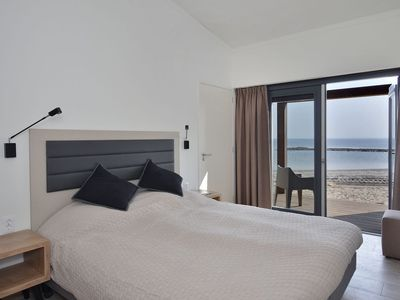 Photo for Enjoy luxury, peace and space in a modern and attractive beach villa near the Grevelingenmeer.