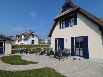 Photo for New family-friendly thatched house right on the playground - with sauna & fireplace