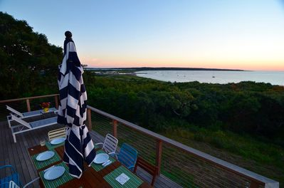 Deck with sunset water views of Menemsha Harbor & Gay Head Lighthouse.