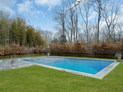 Photo for Delightful home with beautiful lawn and heated pool