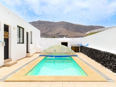 Photo for Famara Beach House on the Shore with Pool, Terrace, Gorgeous Ocean/Mountain Views & Wi-Fi; Parking Available, Pets Allowed