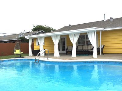 Photo for Renovated home, Private oasis, resortlike home,pool,Tiki bar short walk to beach