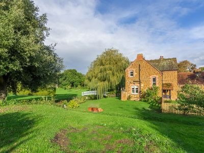 Photo for This charming carrstone Victorian cottage offers wonderful parkland views.