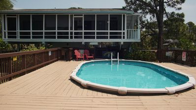 Photo for Private pool, boat dock & screened porches - 1.5 blocks to public beach access.