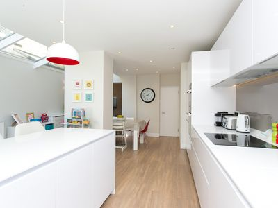 Photo for Beautiful contemporary 4 bed home by Clapham Common, sleeps 7 (Veeve)