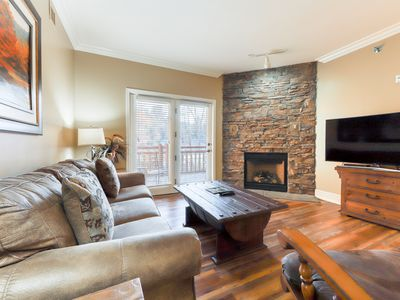 Photo for Beautiful downtown condo w/ shared pool, hot tub & fitness room!