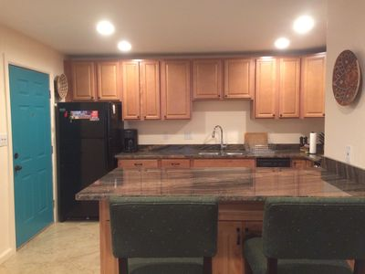 Kitchen with new appliances and breakfast bar