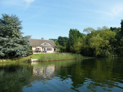 Photo for Luxury Lakeside Home In extensive grounds with boats, canoes and tennis court.