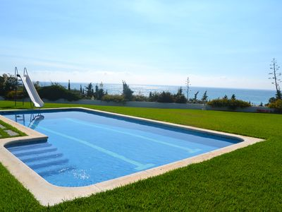 Photo for Large house with swimingpool, magnificient sea view, in front the beach. WIFI