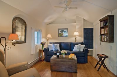 The living area is cozy + sweet, with a flat screen HDTV with a Blu-Ray player