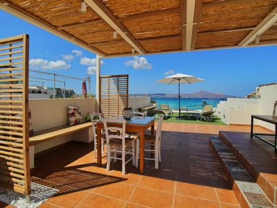 Photo for Floor apartment with superb roof terrace, next to Almirida sandy beach