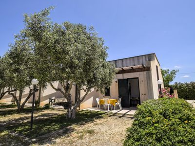 Photo for Lovely apartment for 4 guests with pool, WIFI, A/C, TV, pets allowed and parking
