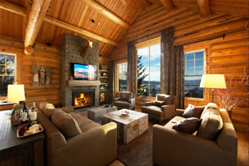 Elevated view, contemporary mountain decor, wood burning fire, 60' smart TV