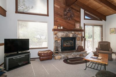 great room with big comfy sofas and gas fireplace