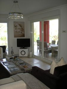 Photo for Luxury 3 bedroom apartment in Juan- les- Pins with large garden and terrace