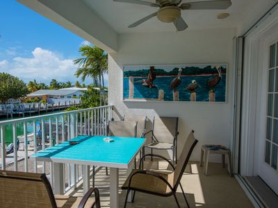 Photo for Tropical Waterfront Paradise!!! 30 ft dock AND easy walk to 400ft beach club