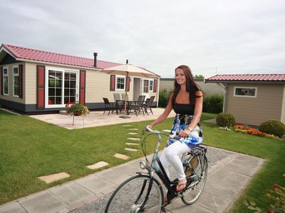Photo for A luxury comfortable chalet in a holiday park, directly by the Waddenzee