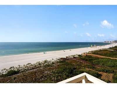 Photo for Alluring beachfront condo with 180-degree ocean views & heated pool