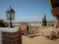 Lovely apartment with great terrace and views. 10-15 min walk to beach which is sandy and clean