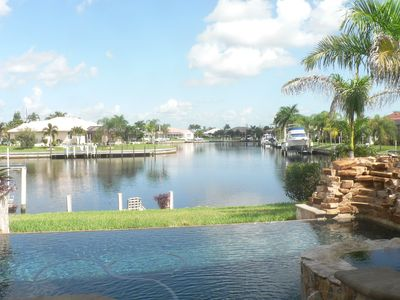Photo for Tropical Waterfront Paradise With Fantastic Fishing Right In The Back Yard.