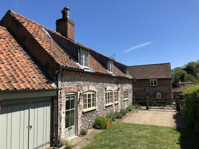 Photo for Traditional cottage. Sleeps 6 - large garden, close to Wells. Great for families