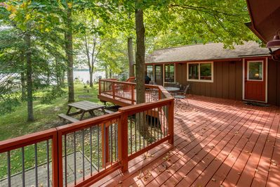 Large Deck overlooking lakeside and spacious yard.